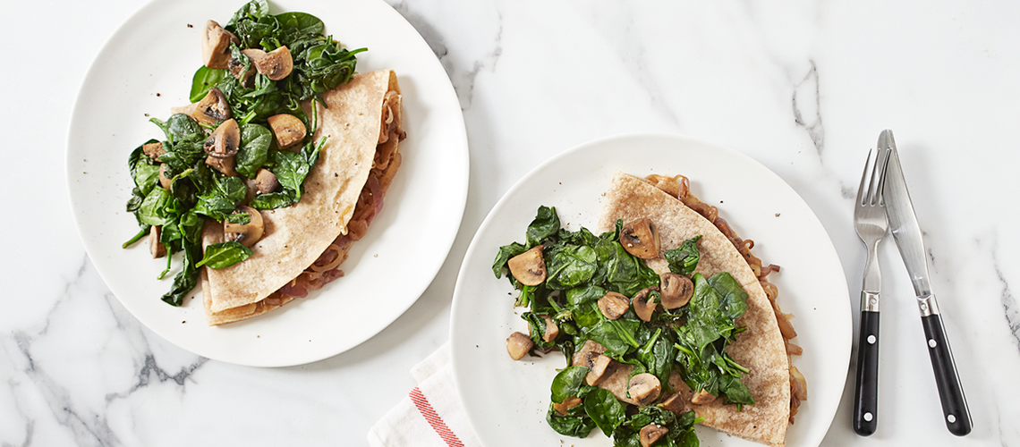 Large vegan caramelized onion crepes with warm spinach mushr..